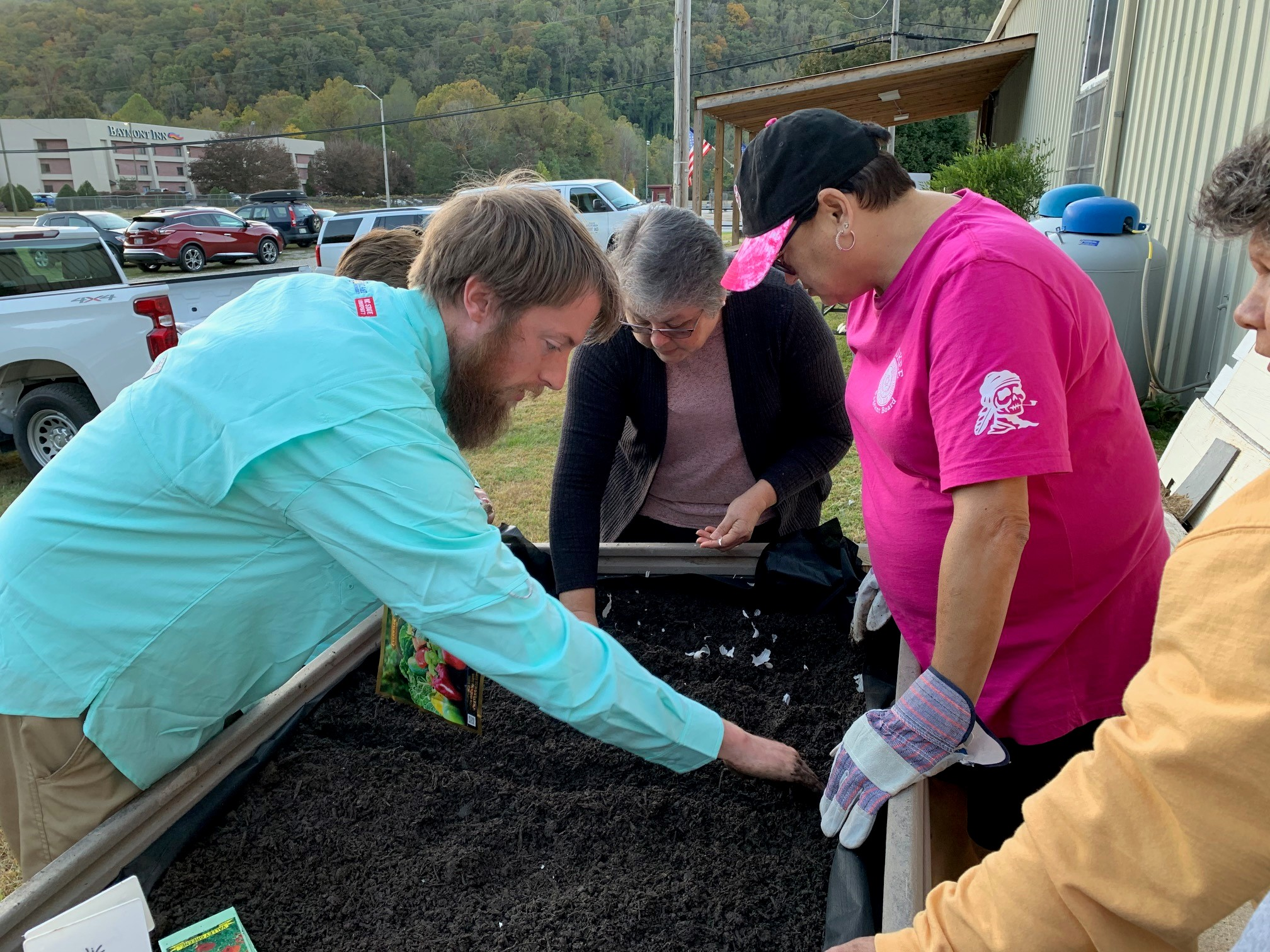 Agriculture agent, Benjamin Collette, conducts raised bed workshop with EBCI